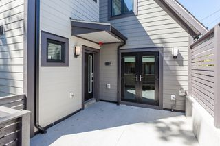 Photo 1: 2297 E 37TH Avenue in Vancouver: Victoria VE Townhouse for sale (Vancouver East)  : MLS®# R2210897