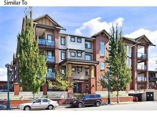 "Photo 1: 215 5650 201A Street in Langley: Langley City Condo for sale in ""Paddington Station"" : MLS®# R2226144"