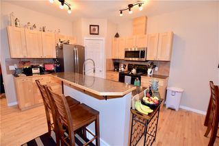 Photo 3: 748 Carriage Lane Drive: Carstairs House for sale : MLS®# C4165695