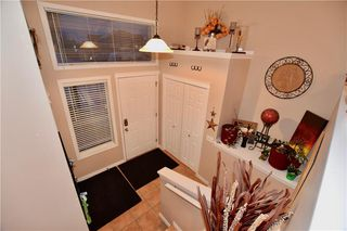 Photo 2: 748 Carriage Lane Drive: Carstairs House for sale : MLS®# C4165695
