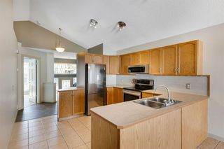Photo 4: 251 TUSCANY VALLEY Drive NW in Calgary: Tuscany Detached for sale : MLS®# A1030021