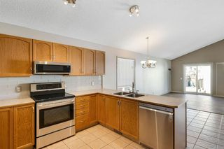 Photo 5: 251 TUSCANY VALLEY Drive NW in Calgary: Tuscany Detached for sale : MLS®# A1030021