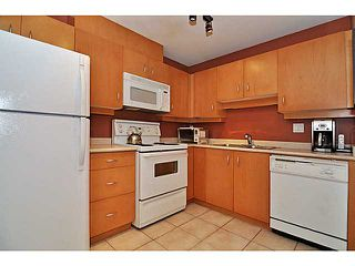 "Photo 4: 207 108 W ESPLANADE Avenue in North Vancouver: Lower Lonsdale Condo for sale in ""Tradewinds"" : MLS®# V976734"