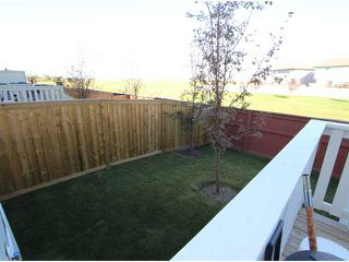 Photo 4: 4904 1001 EIGHTH Street NW: Airdrie Townhouse for sale : MLS®# C3635945