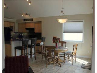 Photo 9: 68 CRYSTAL SHORES Place: Okotoks House for sale : MLS®# C4066673
