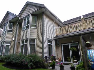 "Photo 2: 26 50 HETT CREEK Drive in Port Moody: Heritage Mountain Townhouse for sale in ""Mountainside"" : MLS®# R2080475"