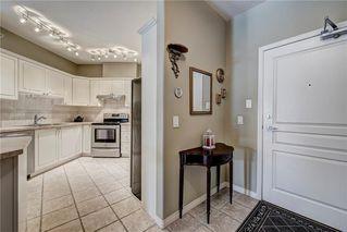 Photo 3: 2201 LAKE FRASER Court SE in Calgary: Lake Bonavista Apartment for sale : MLS®# C4223049