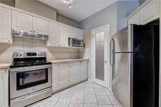 Photo 9: 2201 LAKE FRASER Court SE in Calgary: Lake Bonavista Apartment for sale : MLS®# C4223049