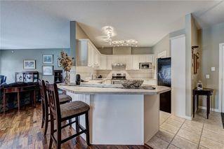 Photo 10: 2201 LAKE FRASER Court SE in Calgary: Lake Bonavista Apartment for sale : MLS®# C4223049