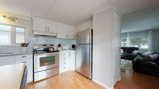 """Photo 39: 8908 75 Street in Fort St. John: Fort St. John - City SE Manufactured Home for sale in """"SOUTH ANNEOFIELD"""" (Fort St. John (Zone 60))  : MLS®# R2412701"""