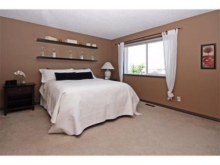 Photo 20: 18 CRYSTAL SHORES Place: Okotoks House for sale : MLS®# C4018955