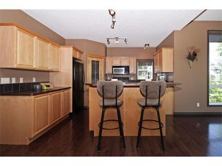 Photo 5: 18 CRYSTAL SHORES Place: Okotoks House for sale : MLS®# C4018955