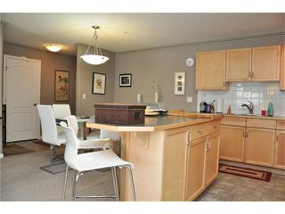 Photo 9: 2115 303 ARBOUR CREST Drive NW in Calgary: Arbour Lake Condo for sale : MLS®# C4092721