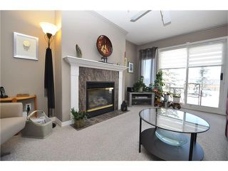 Photo 2: 2115 303 ARBOUR CREST Drive NW in Calgary: Arbour Lake Condo for sale : MLS®# C4092721