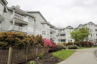 "Photo 1: 209 13939 LAUREL Drive in Surrey: Whalley Condo for sale in ""King George Manor"" (North Surrey)  : MLS®# R2168699"