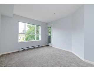 "Photo 9: 209 5465 203 Street in Langley: Langley City Condo for sale in ""Station 54"" : MLS®# R2394003"