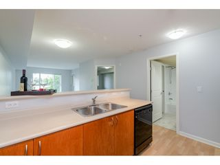 "Photo 7: 209 5465 203 Street in Langley: Langley City Condo for sale in ""Station 54"" : MLS®# R2394003"