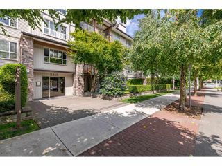"Photo 1: 209 5465 203 Street in Langley: Langley City Condo for sale in ""Station 54"" : MLS®# R2394003"