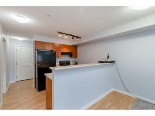"Photo 3: 209 5465 203 Street in Langley: Langley City Condo for sale in ""Station 54"" : MLS®# R2394003"
