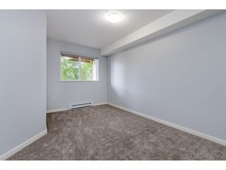 "Photo 12: 209 5465 203 Street in Langley: Langley City Condo for sale in ""Station 54"" : MLS®# R2394003"