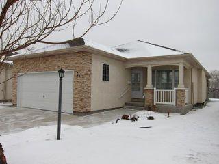 Photo 1: 64 Wyndstone Circle in BIRDSHILL: Birdshill Area Condominium for sale (North East Winnipeg)  : MLS®# 1200654