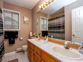 "Photo 11: 8336 141ST Street in Surrey: Bear Creek Green Timbers House for sale in ""Brookside"" : MLS®# F1402000"