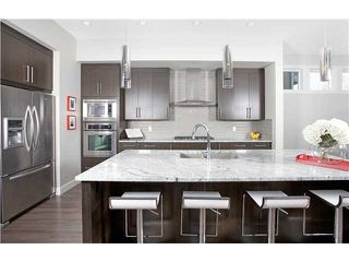 Photo 2: 810 7 Avenue NE in CALGARY: Renfrew_Regal Terrace Residential Detached Single Family for sale (Calgary)  : MLS®# C3604291