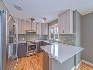 Photo 3: 55 ROCKLEDGE Terrace NW in Calgary: Rocky Ridge Ranch House  : MLS®# C4005810
