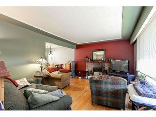 Photo 2: 714 IVY Avenue in Coquitlam: Coquitlam West House for sale : MLS®# V1131997