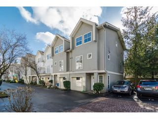 "Photo 1: 401 14188 103A Avenue in Surrey: Whalley Townhouse for sale in ""Ashbury Lane"" (North Surrey)  : MLS®# R2140903"