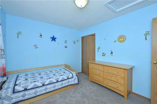 Photo 32: 41 BRIDLERIDGE Gardens SW in Calgary: Bridlewood House for sale : MLS®# C4135340