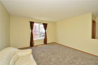 Photo 20: 41 BRIDLERIDGE Gardens SW in Calgary: Bridlewood House for sale : MLS®# C4135340