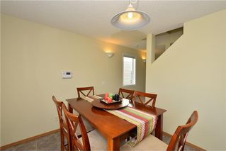 Photo 13: 41 BRIDLERIDGE Gardens SW in Calgary: Bridlewood House for sale : MLS®# C4135340