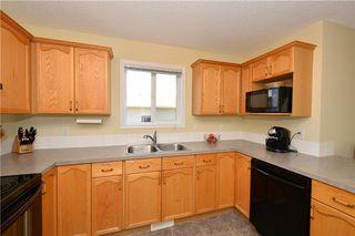 Photo 6: 41 BRIDLERIDGE Gardens SW in Calgary: Bridlewood House for sale : MLS®# C4135340