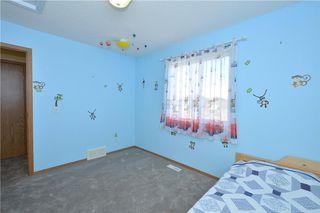 Photo 34: 41 BRIDLERIDGE Gardens SW in Calgary: Bridlewood House for sale : MLS®# C4135340