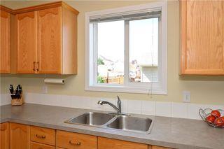 Photo 9: 41 BRIDLERIDGE Gardens SW in Calgary: Bridlewood House for sale : MLS®# C4135340