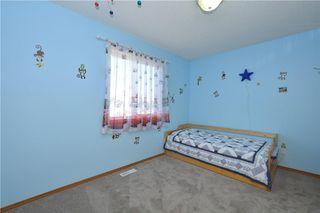 Photo 33: 41 BRIDLERIDGE Gardens SW in Calgary: Bridlewood House for sale : MLS®# C4135340