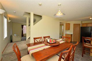 Photo 14: 41 BRIDLERIDGE Gardens SW in Calgary: Bridlewood House for sale : MLS®# C4135340