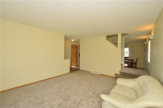 Photo 18: 41 BRIDLERIDGE Gardens SW in Calgary: Bridlewood House for sale : MLS®# C4135340