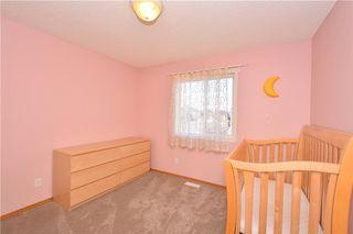 Photo 31: 41 BRIDLERIDGE Gardens SW in Calgary: Bridlewood House for sale : MLS®# C4135340