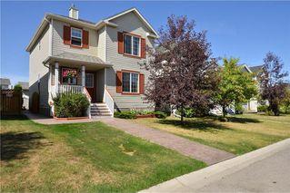 Photo 1: 41 BRIDLERIDGE Gardens SW in Calgary: Bridlewood House for sale : MLS®# C4135340