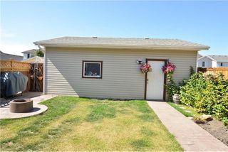 Photo 45: 41 BRIDLERIDGE Gardens SW in Calgary: Bridlewood House for sale : MLS®# C4135340