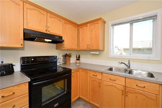 Photo 7: 41 BRIDLERIDGE Gardens SW in Calgary: Bridlewood House for sale : MLS®# C4135340