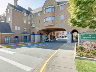 "Photo 1: 207 1369 56 Street in Delta: Cliff Drive Condo for sale in ""WINDSOR WOODS"" (Tsawwassen)  : MLS®# R2414087"