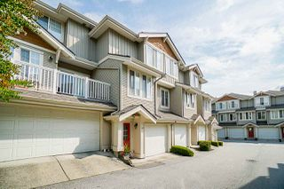 "Photo 1: 37 14877 58 Avenue in Surrey: Sullivan Station Townhouse for sale in ""Redmill"" : MLS®# R2486126"