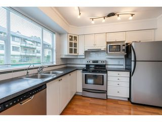 """Photo 7: 107 20120 56 Avenue in Langley: Langley City Condo for sale in """"Blackberry Lane 1"""" : MLS®# R2495624"""