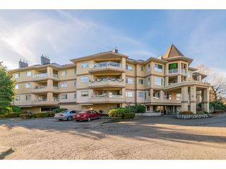 "Photo 1: 107 20120 56 Avenue in Langley: Langley City Condo for sale in ""Blackberry Lane 1"" : MLS®# R2495624"