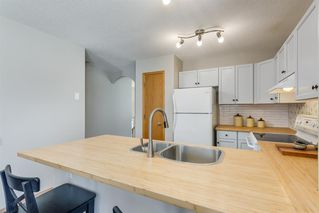 Photo 6: 142 Creekside Bay NW: Airdrie Detached for sale : MLS®# A1047385