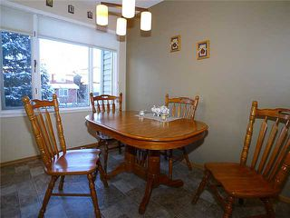 Photo 5: 1409 1 Street NE in Calgary: Crescent Heights Townhouse for sale : MLS®# C3648539