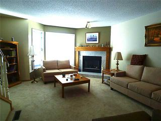 Photo 2: 1409 1 Street NE in Calgary: Crescent Heights Townhouse for sale : MLS®# C3648539